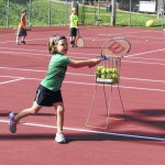 Camp exposes kids to tennis at young age