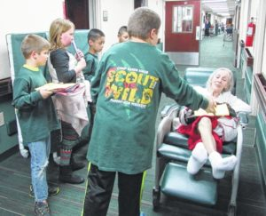 Scouts makechristmas for elderly